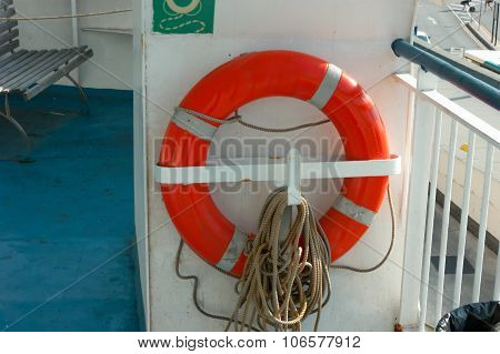 Red lifebuoy attached to a metallic mount