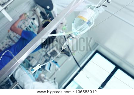 Nurse Working In The Patient's Room