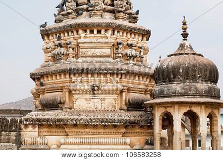 Birds On The Vintage Stone Towers Of Indian Temple