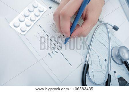 Doctor Fills Documentation