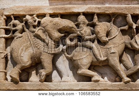 Caravan Of Elephants And Horses On The Relief On Ruined Wall Of Temple In India