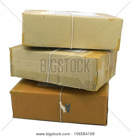 Group Of Parcels Boxes Wrapped With Brown Tape And Tied With String. Isolated On White Background