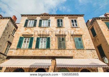 Wide angle shot of the houses facades on Stradun street in Dubrovnik, Croatia
