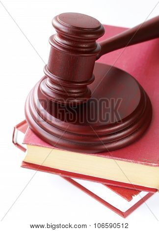 wooden gavel on a stand on a white background
