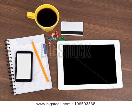Blank copybook with tablet and smartphone