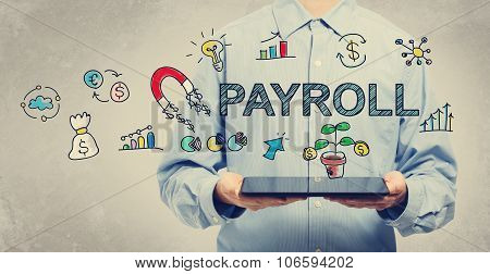 Payroll Concept With Young Man Holding A Tablet