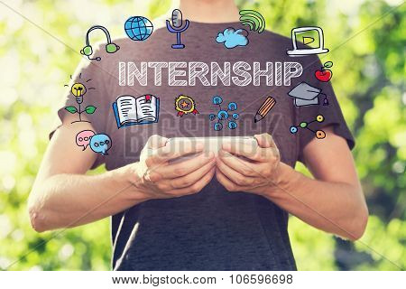 Internship Concept With Young Man Holding His Smartphone