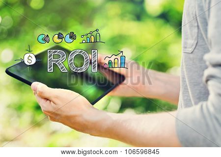Roi Concept With Young Man Holding His Tablet Computer