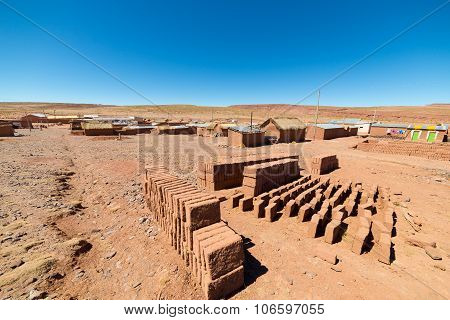 Adobe Village On The Desertic Andean Highlands In Bolivia