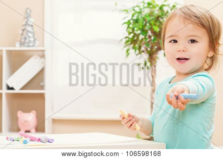 Happy Toddler Girl Playing With Chalk