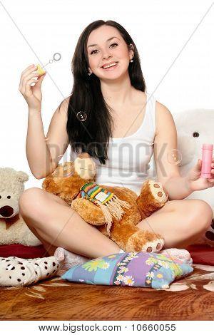 Joyful Girl Blow Bubbles. Isolated