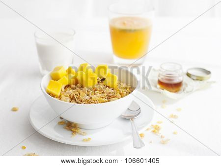 Healthy breakfast. Corn flakes, muesli, granola, with fresh orange juice