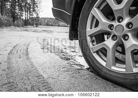 Car Wheel With Light Alloy Disc On Dirty Country Road