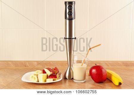 Fresh fruit glasses and blender to prepare dessert milkshake