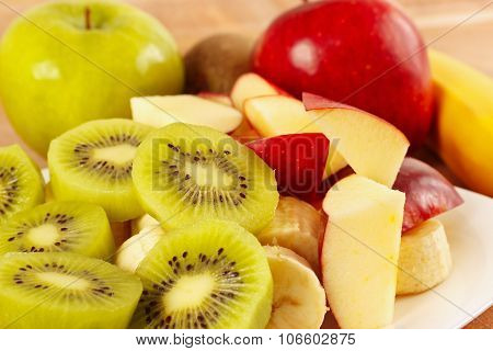 Fresh whole and sliced fruit closeup