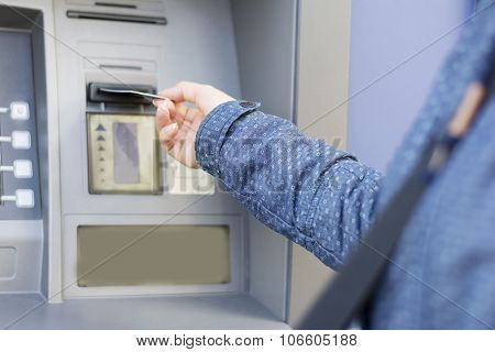 Woman In Blue Jacket At Atm