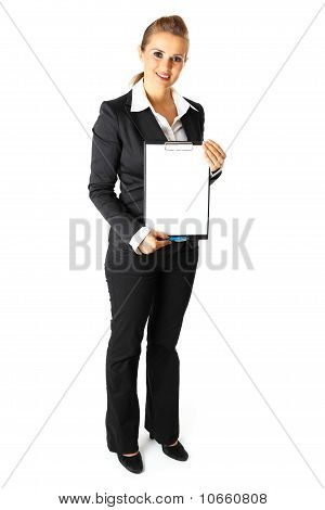 Full length portrait of friendly modern business woman holding blank clipboard in hands