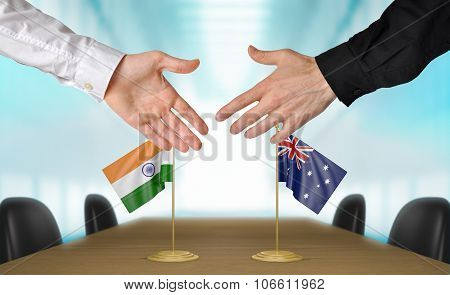 India and Australia diplomats agreeing on a deal