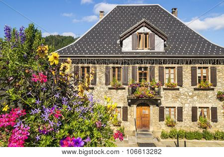 Outdoor flowers in front of a French house