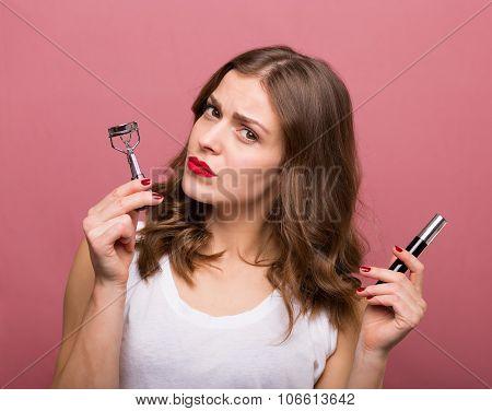 Beautiful Woman With A Eyelash Curler