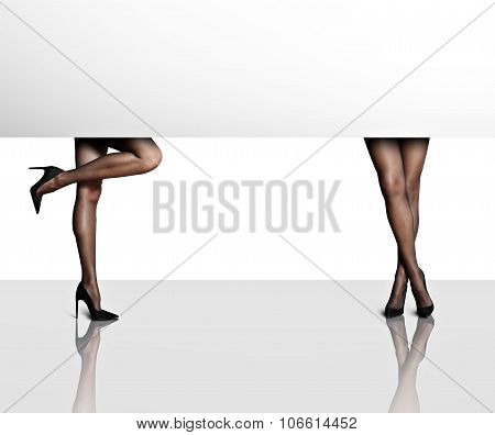Two Woman's Legs In A White Space With Reflection
