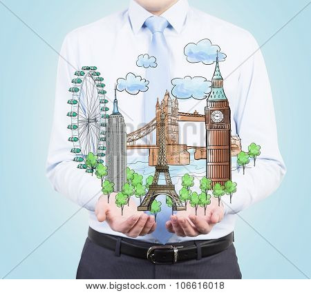 A Person In Formal Clothes Holds In His Hands A Sketch Of Famous Places From All Over The World. Lig