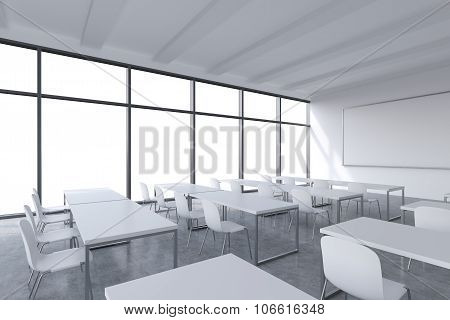 A Modern Panoramic Classroom With White Copy Space In The Windows. White Tables And White Chairs And