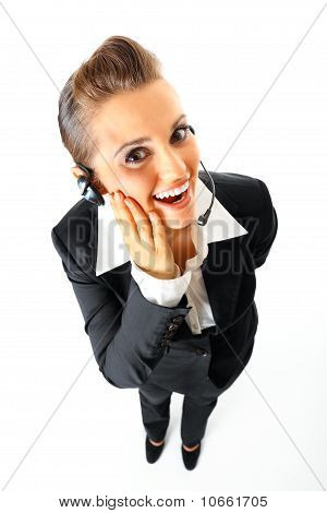 Full length portrait of pleased telephone operator with headset