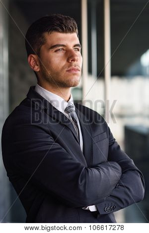 Young Businessman Near A Office Building Wearing Black Suit
