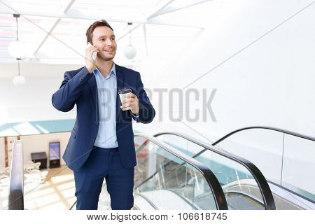 Young gentleman is speaking on the phone