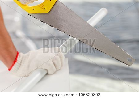 Professional male carpenter is working with equipment