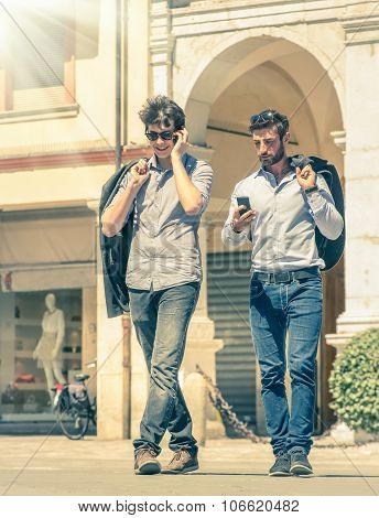 Young Business Men In The City Main Square With Smartphone Having A Break After A Working Day
