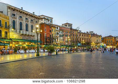 People Enjoy Walking At Piazza Bra
