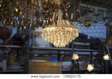 Luster On A Flea Market With Other Ceiling Lights