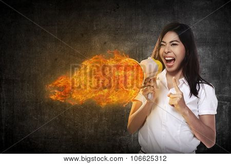 Asian Woman Shouting Megaphone On Fire