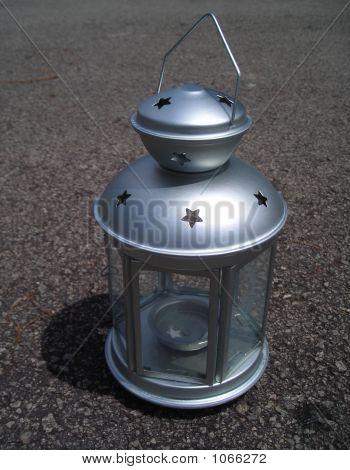 Closeup Silver Lamp On Bituman Background
