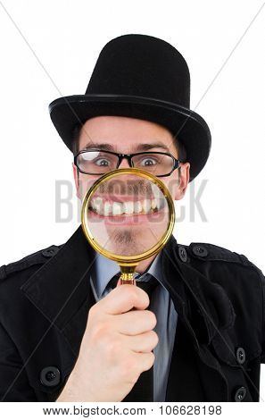 Young detective with magnifying glass isolated on white