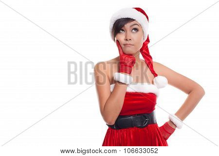 Santa Christmas Woman Looking To The Side Thinking Happy And Playful. Asian Christmas Girl Wearing S