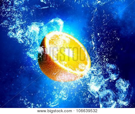 Orange fruit in clear blue water splashes