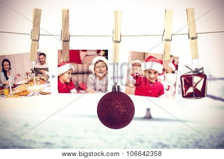 Hanging christmas photos against tree in showy field