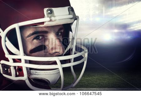 Close up of rugby player against sports pitch