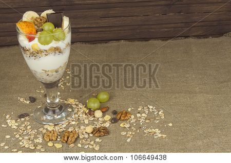 fresh milk in the glass and muesli breakfast. Oatmeal with milk and curd, meals for athletes