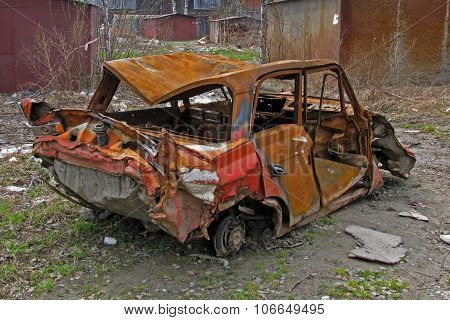 A Rusty Broken Car In The Street