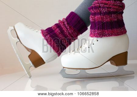 Female Legs In Gaiters And Ice Skates