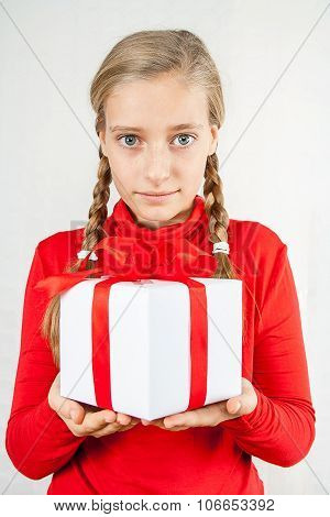 Cute Blond Girl In Red With Gift Box