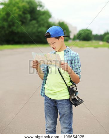 Teenager Boy Tourist Sightseeing City With Paper Map