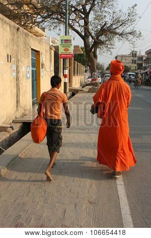 Vrindavan, India, March 17: The priest and his disciple walking on the street in March 17, 2013 in Vrindavan, India.