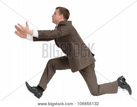 Businessman running fast with empty hands