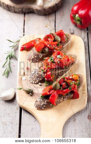 Italian bruschetta, crostini with roasted bell peppers and olive oil