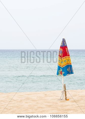 Closed Parasols On The Beach
